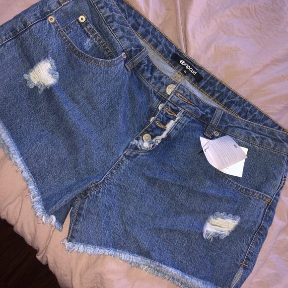 Rip Curl Pants - Ripcurl mid-rise distressed jean shorts